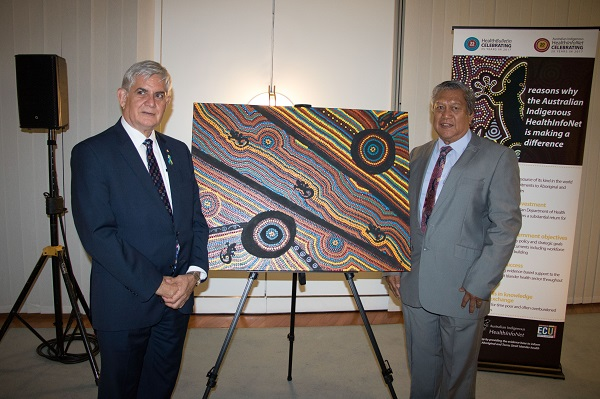 Minister Ken Wyatt and artist Mick Adams with the HealthInfoNet 20th anniversary commissioned artwork in Parliament House Canberra at the official anniversary